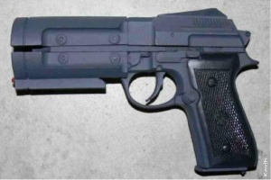 """Resin """"stunt"""" prop of the Dlask Arms Timecop Beretta used for Stargate: Atlantis, due to the rounded trigger guard as opposed to the ones used in the film."""