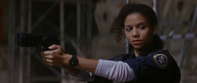 Sarah Fielding (Gloria Reuben) draws her handgun.